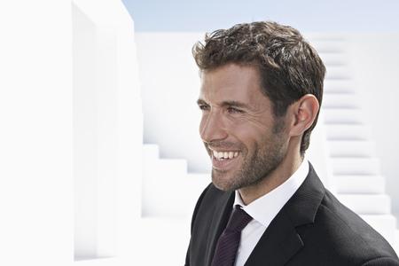 Businessman In Black Suit,Looking Away,Smiling