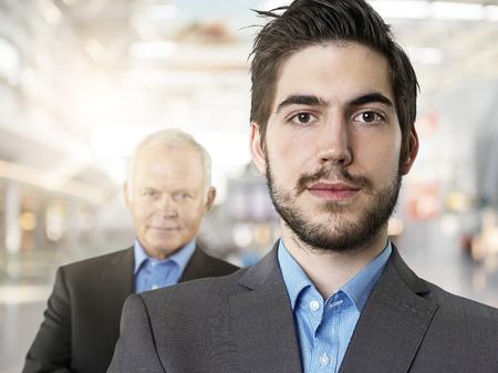 Portrait Of Businessmen,Smiling LANG_EVOIMAGES