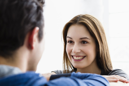 Germany,Munich,Young Couple Looking At Each Other,Smiling
