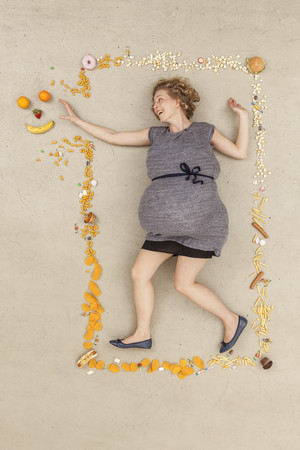 Germany,Berlin,Woman Surrounded With Food LANG_EVOIMAGES