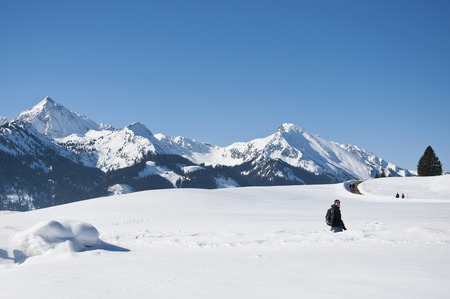 Austria,Woman Hiking At Tannheim Alps In Winter