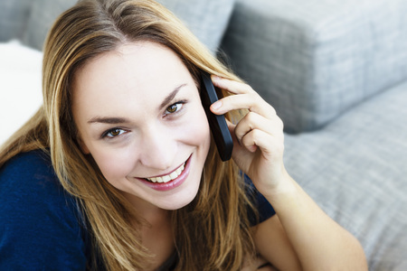 Germany,Bavaria,Munich,Portrait Of Young Woman Talking On Mobile Phone,Close Up