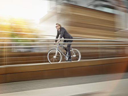 Germany,Cologne,Mature Man Riding Bicycle