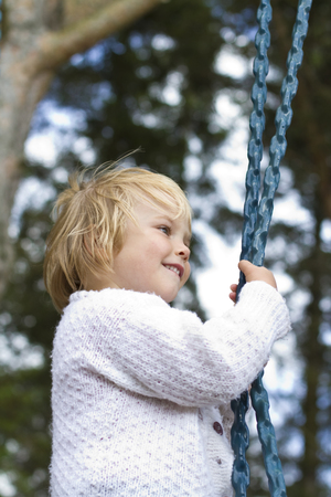 Germany,Girl Standing On Swing LANG_EVOIMAGES