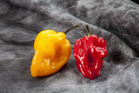 Red And Yellow Habaneros Peppers On Textile LANG_EVOIMAGES