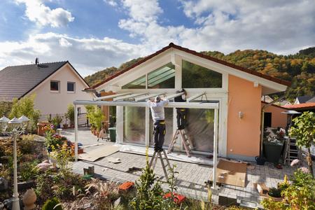 Germany,Rhineland Palatinate,Men Assembling Glass Canopy LANG_EVOIMAGES