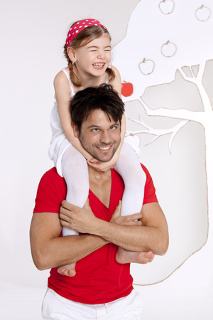 Girl Sitting On Fathers Shoulder And Fooling Around,Smiling LANG_EVOIMAGES
