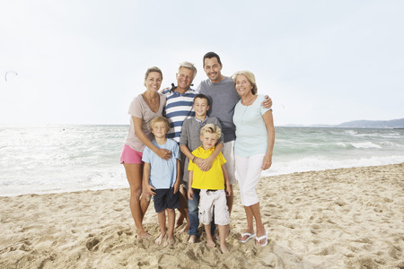 Spain,Portrait Of Family On Beach At Palma De Mallorca,Smiling