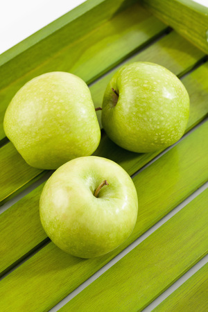Green Apples On Wooden Tray,Close Up