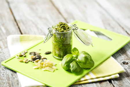 Basil Pesto In Jar With Seeds On Chopping Board,Close Up