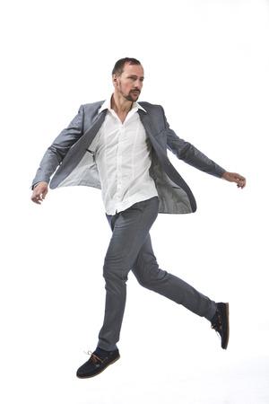 Mature man running on white background LANG_EVOIMAGES