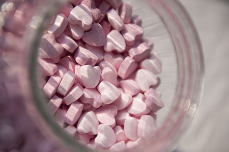 Germany,Bowl of pink candy hearts,close up