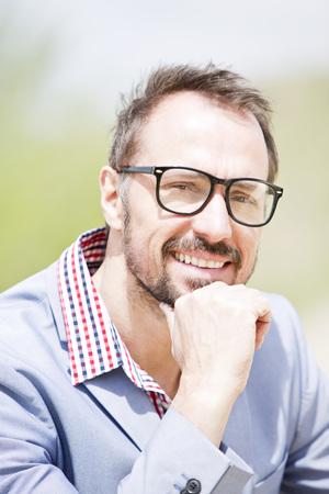 Germany,Bavaria,Portrait of businessman,smiling LANG_EVOIMAGES