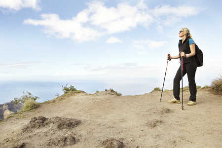USA,Hawaii,Mid adult woman standing on top of mountain LANG_EVOIMAGES