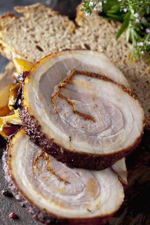 Slices of rolled roast pork,close up LANG_EVOIMAGES