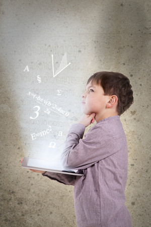 Germany,Brandenburg,Boy thinking with digital tablet LANG_EVOIMAGES