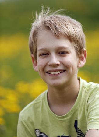 Germany,Baden Wuerttemberg,Portrait of boy in meadow,smiling