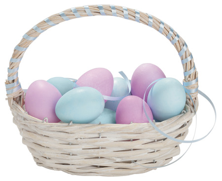 Basket of easter eggs on white background,close up