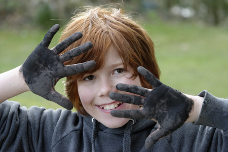 France,Boy showing dirty black hands,Smiling,close up
