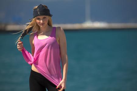 Greece,Young woman posing at sea