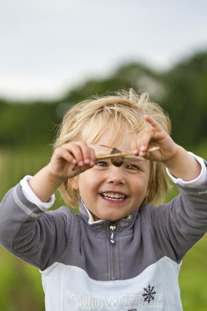 Germany,Kiel,Girl research in nature,smiling