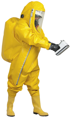 Mature man in yellow protective suit with holding meter for radioactivity