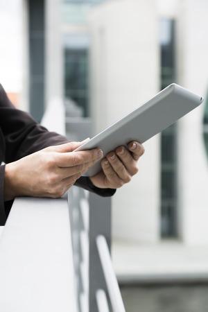 Germany,Berlin,Businesswoman using digital tablet,close up