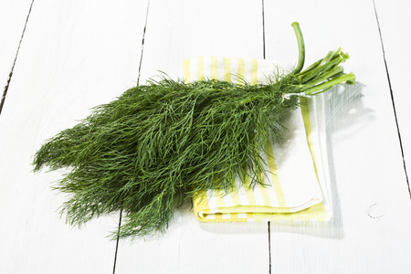 Bunch of fresh dill on wooden table,close up