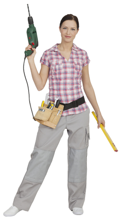 Portrait of young woman holding drill and spirit level,smiling