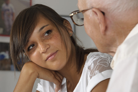 Germany,Baden Wuerttemberg,Grandfather and granddaughter talking to each other,close up LANG_EVOIMAGES