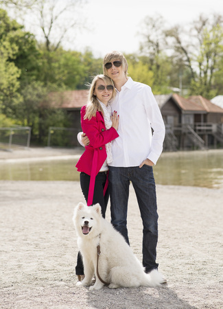 Germany,Bavaria,Portrait of couple standing with dog LANG_EVOIMAGES