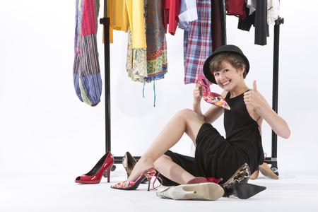 Girl fitting wardrobe of her mother,smiling LANG_EVOIMAGES