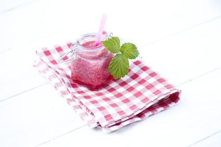 Raspberry smoothie on napkin,close up