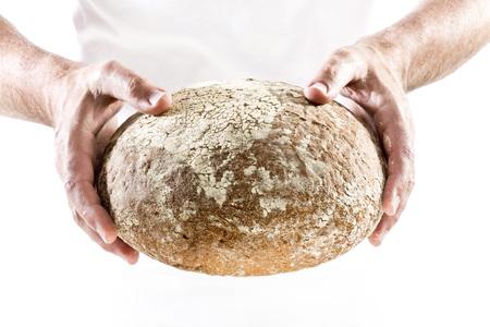 Mature man holding bread,close up LANG_EVOIMAGES