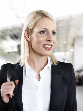 Businesswoman at airport,looking away