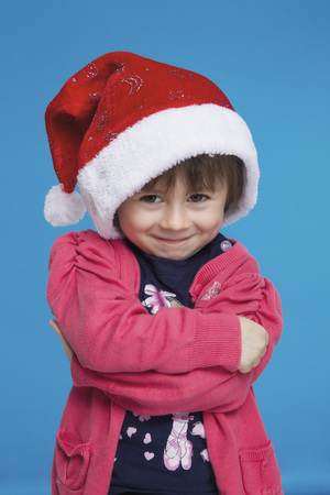 Portrait of girl with santa hat,smiling LANG_EVOIMAGES