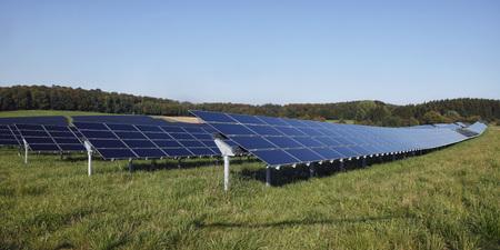 Germany,Bavaria,Solar panels on grass against sky