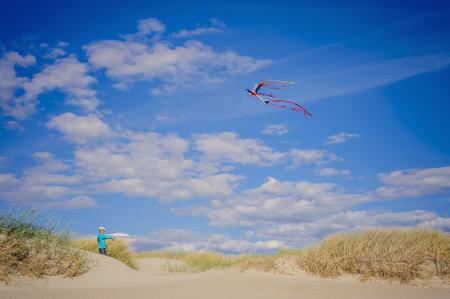 Denmark,Romo,Boy flying kite at North Sea LANG_EVOIMAGES