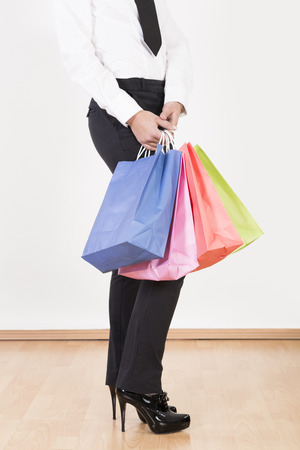Young woman holding shopping bags,close up LANG_EVOIMAGES