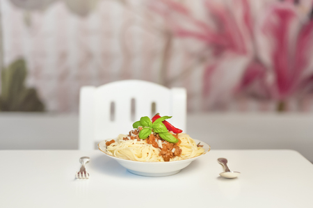 Germany,Saxony,Spaghetti with fork and spoon on table,close up