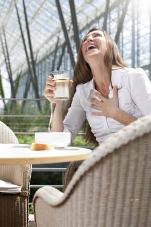 Businesswoman having lunch break LANG_EVOIMAGES