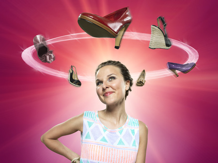 Smiling young woman looking at flying shoes,Composite LANG_EVOIMAGES
