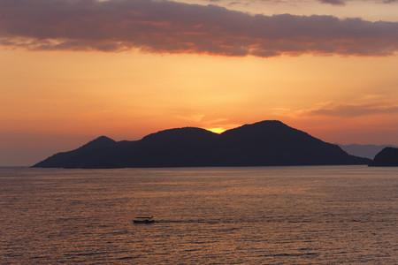 Turkey,Mugla,Fethiye,Island at sunset at Lycian coast