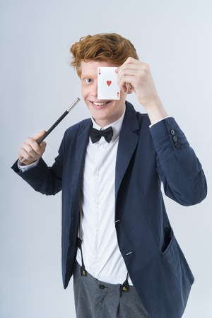 Portrait of young man showing magic of cards LANG_EVOIMAGES