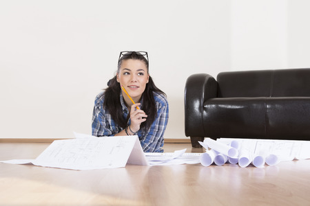 Young woman planning her first apartment,smiling