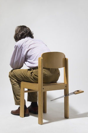 Mature man sitting on chair