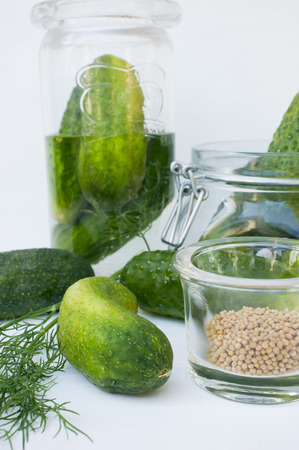 Preparing cucumber pickle with dill and mustard seeds LANG_EVOIMAGES