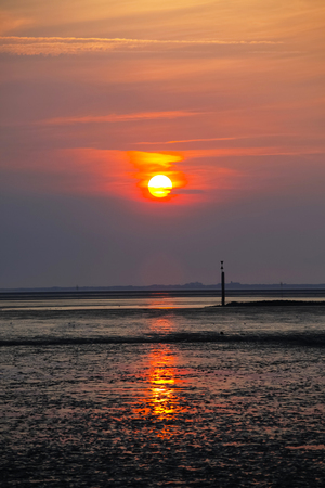 Germany,View of low tide at north sea during sunset