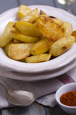 Potatoe wedges from oven on plates