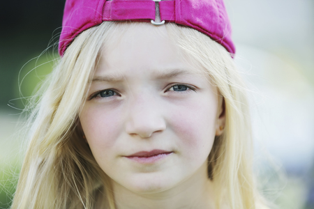 Germany,North Rhine Westphalia,Cologne,Portrait of girl with cap,close up